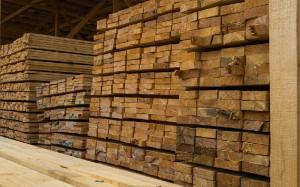 Lots of planks stacked on top of each other in the warehouse. Lumber for further use in construction